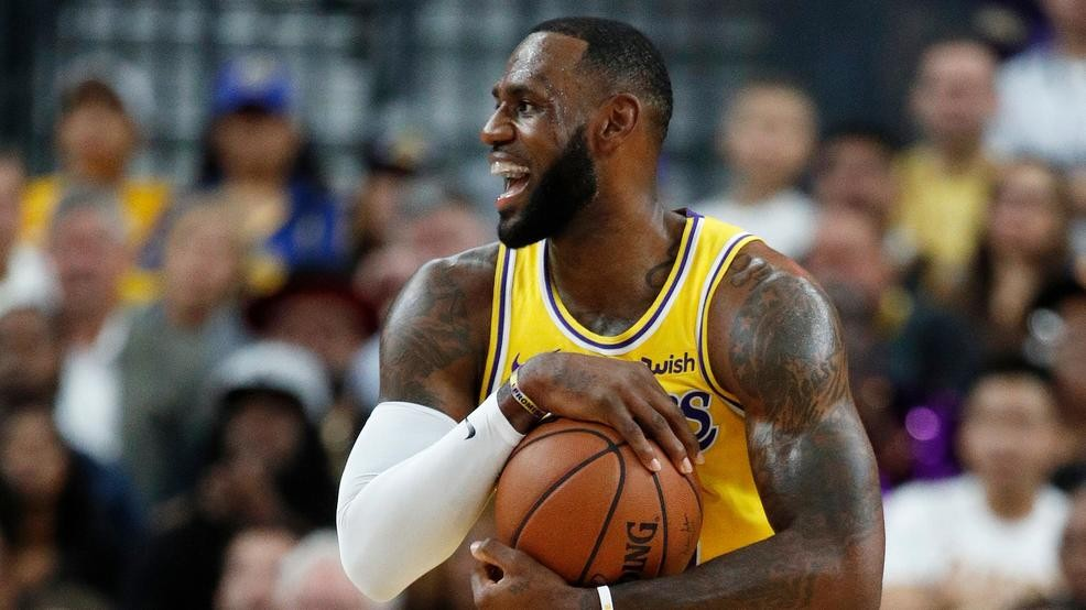 7e9ed73cb FILE - Los Angeles Lakers forward LeBron James reacts after a play against  the Golden State Warriors during the first half of an NBA preseason  basketball ...