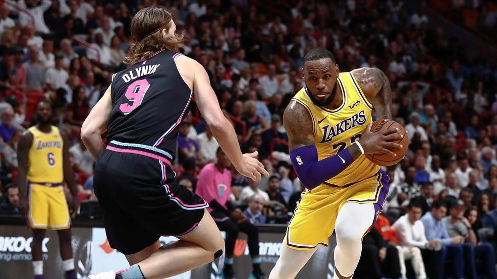 ba53f919e Los Angeles Lakers forward LeBron James drives against Miami Heat forward  Kelly Olynyk during the first half of an NBA basketball game Sunday